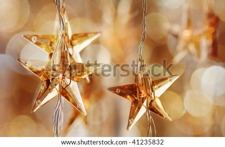 Golden Christmas stars with very shallow focus - stock photo
