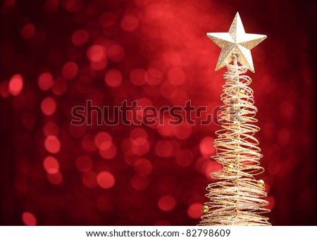 Golden christmas tree on abstract light background. - stock photo