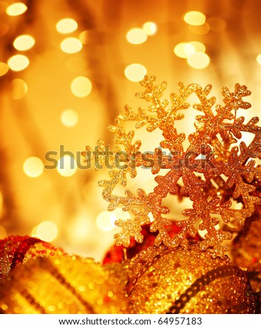 Golden Christmas tree ornament and holiday decoration with snowflake & blur lights - stock photo