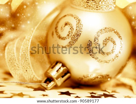 Golden Christmas tree ornament, winter holidays decoration, ornamental decorative bauble, gold background with magic glowing sparks