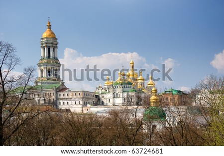Golden church domes on blue sky background - stock photo