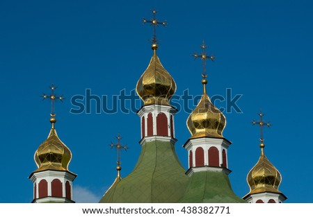 Golden church domes  over blue sky
