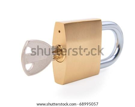 golden closed padlock with key - stock photo