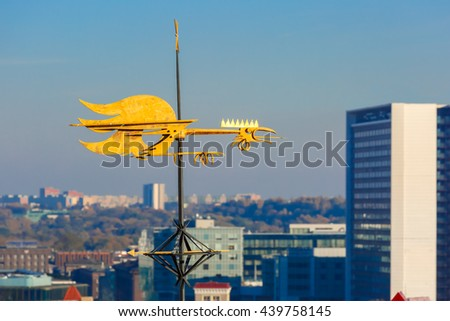 Golden Cockerel weather vane and modern office buildings skyscrapers in the background in Tallinn in the day, Estonia - stock photo