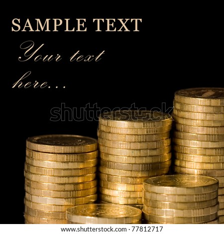 Golden coins isolated on black background - stock photo