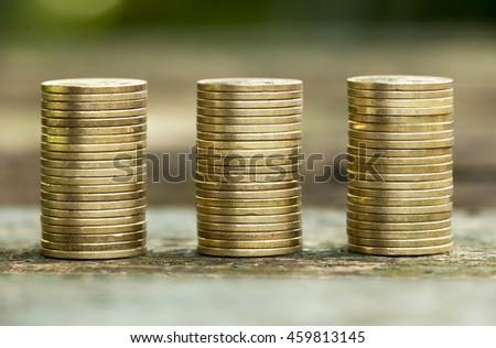 Golden coins - money savings concept - stock photo