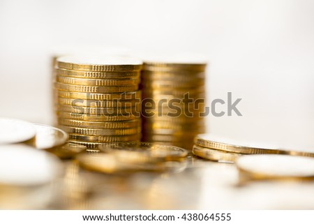 golden coins on the wooden table