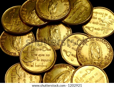 Golden coins used for marriages in Mexico and Latin America called arras