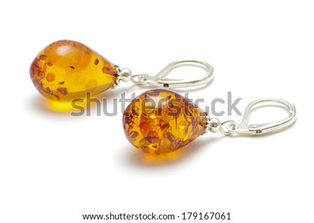 Golden color Baltic amber earrings isolated on the white background - stock photo