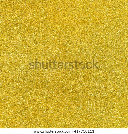 Golden color glitter abstract background texture.Gold texture with glitter. Golden background. - stock photo