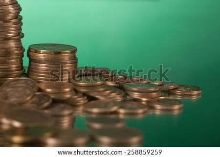 Golden columns of coins on green background. Copy space. Banking. Go to Bank - stock photo