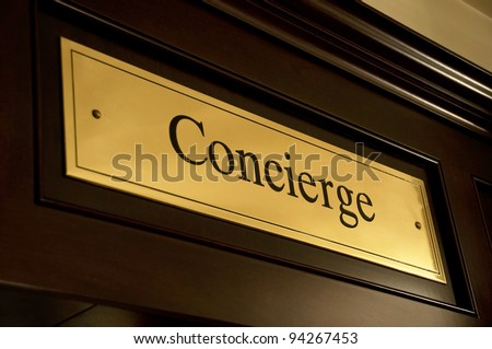 Golden concierge sign in a luxury hotel - stock photo
