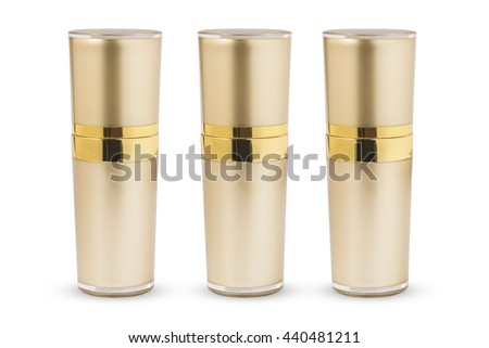 Golden cosmetic cans of moisturizer isolated on white background. Has clipping path.