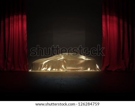 golden covered, New car presentation on show stage - stock photo