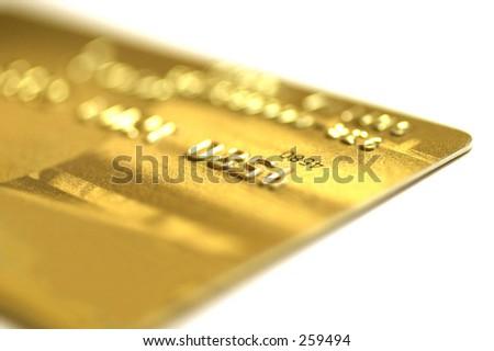 Golden credit card, macro, very shallow DOF. - stock photo