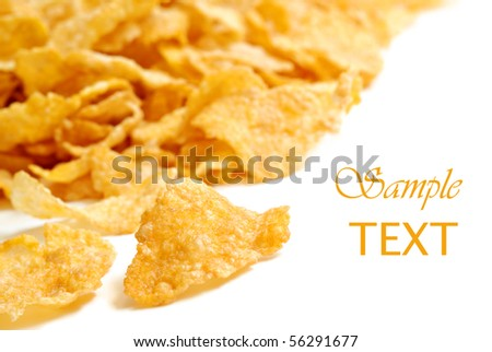 Golden crispy corn flakes on white background with copy space.  Macro with extremely shallow dof. - stock photo