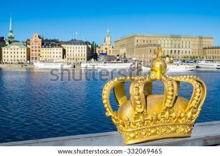 Golden Crown on a Skeppsholmsbron bridge. Stockholm, Sweden - stock photo