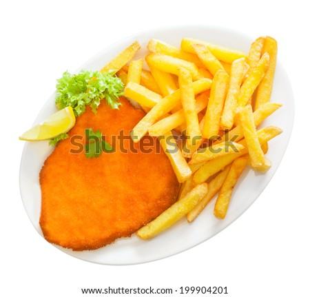 Golden crumbed veal schnitzel served with crisp potato chips or batons garnished with fresh frilly lettuce and lemon on a white platter, isolated on white - stock photo