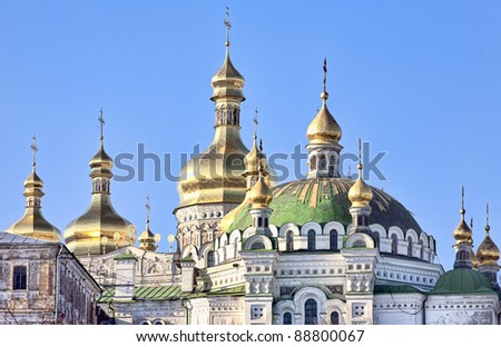 Golden cupolas with crosses of the Assumption cathedral in Kiev Pechersk Lavra Orthodox monastery, Kiev, Ukraine - stock photo
