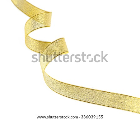 Golden curly ribbon isolated on white - stock photo