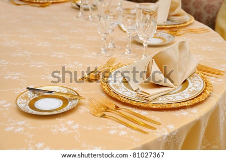 Golden cutlery with crystal glass - stock photo