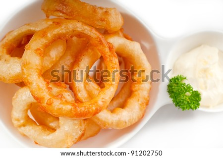 golden deep fried onion rings and vegetables - stock photo