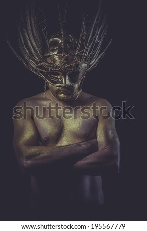 golden deity, man with wings and gold helmet - stock photo