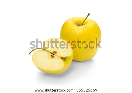 Golden Delicious apple on a white background - stock photo