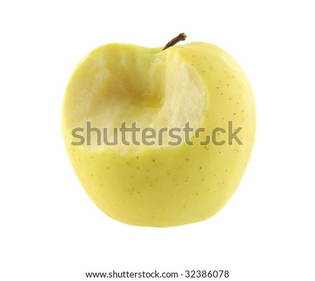 Golden delicious apple with one bite - stock photo