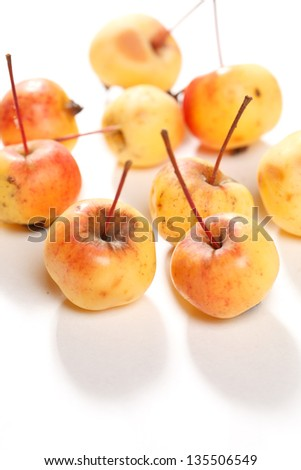 golden delicious juicy apples on white - stock photo