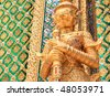 Golden demon statue temple decoration at Wat prakaew, Bangkok, Thailand - stock photo