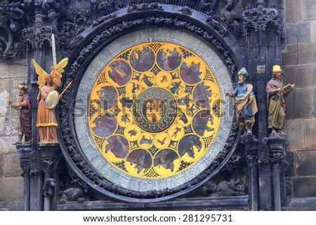 Golden dial decorated with statues of the Astronomical Clock, Prague, Czech Republic - stock photo