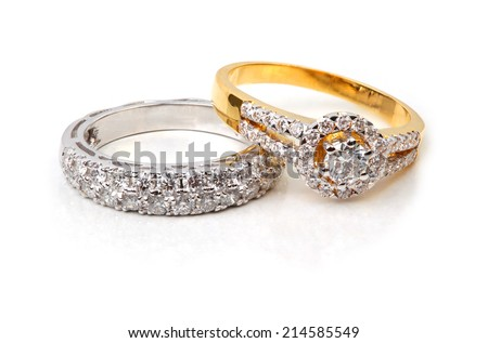 Golden diamond ring and contemporary diamond, isolated on white background - stock photo