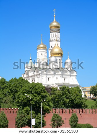 Golden dome in Moscow Kremlin over blue sky