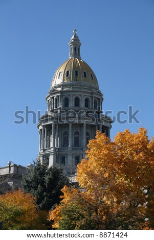 Golden dome of Denver State capitol in autumn