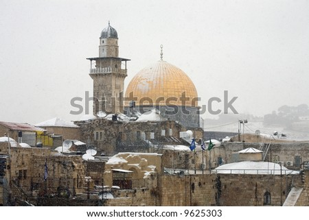 Golden dome of Jerusalem with rare snow. - stock photo