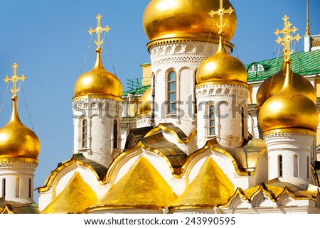Golden domes of Annunciation Cathedral on Cathedral Square in the Moscow Kremlin, Russia - stock photo