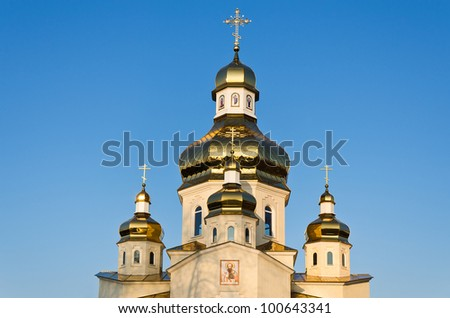 Golden domes of Orthodox Church on the blue sky - stock photo