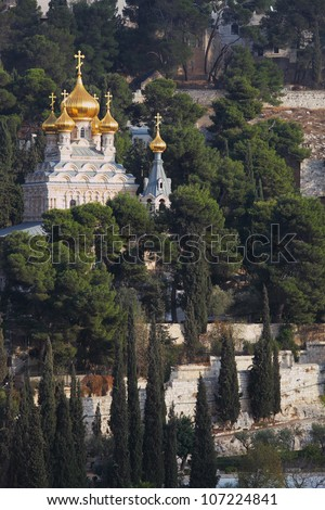 Golden domes of the Church of Mary Magdalene and cypresses. Mount of Olives, Jerusalem - stock photo
