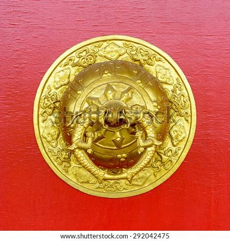 Golden door knocker at Kapan buddhist monastery, Nepal - stock photo