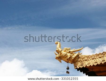 Golden dragon head roof decoration at Jokhang Temple in Lhasa, Tibet - stock photo