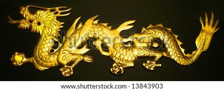 Golden Dragon on Black Background - stock photo