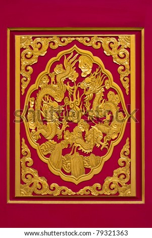 golden dragon on red background in chinese temple, Thailand - stock photo