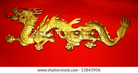 Golden Dragon on Red Satin Background - stock photo