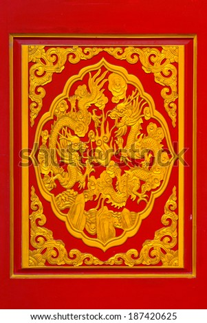 Golden dragon sculpture on ceiling at Chinese Temple, Bangkok, Thailand