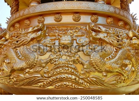 Golden dragon sculpture on incense burner in the public Chinese temple. - stock photo
