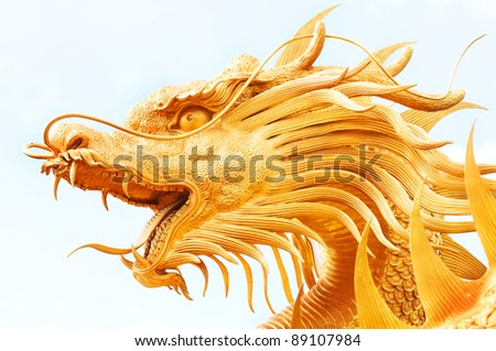 Golden dragon statue isolated on white background - stock photo