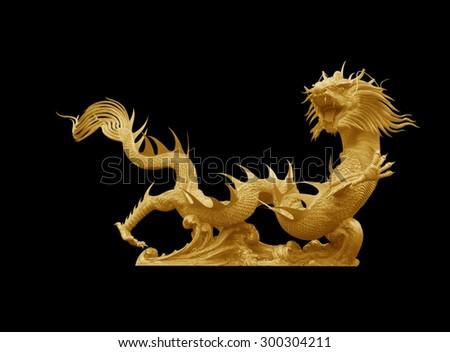 Golden dragon statue on black  background - stock photo