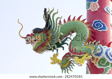 Golden dragon statue on pole, Thailand, Dragon prominently in the beautiful sky. - stock photo