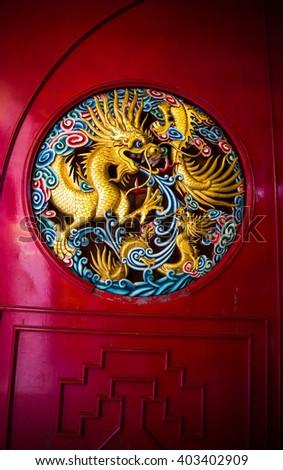 Golden dragon statue on the door - stock photo